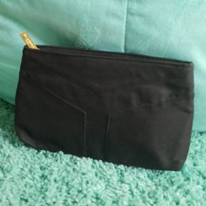 Black cloth cosmetic bag ( free with purchase)